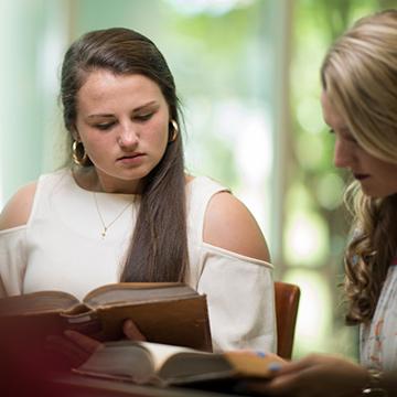 2 females studying