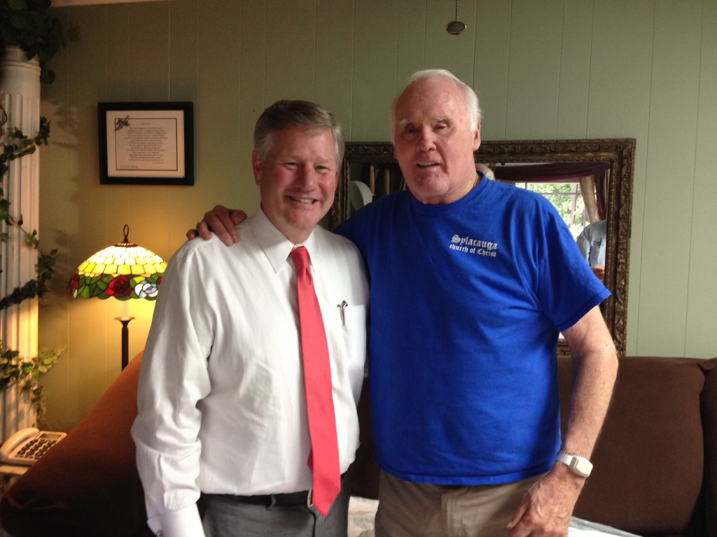 Dr. Jack Zorn, right, stands with his arm around Faulkner President Mike Williams.