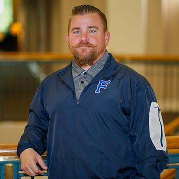 Head Coach Kyle Beard Posing for Photo