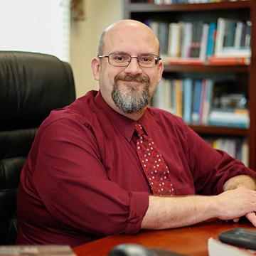 Associate Professor Todd Brenamen Posing for Photo