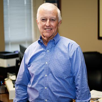 Financial Aid Director William Buddy Jackson Posing for Photo