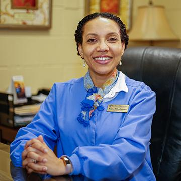 University Nurse Senta Bargel Posing for Photo