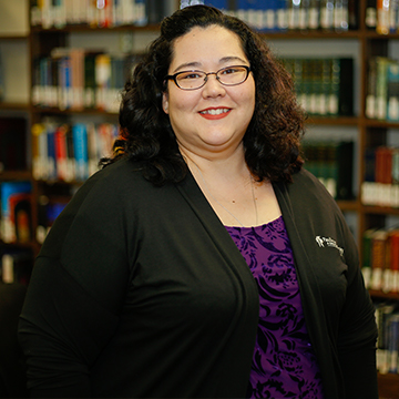 Assistant Director of Libraries Angie Moore Posing for Photo