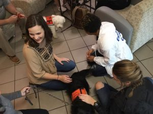 Student stopped by Cafe Sienna on Monday to pet therapy dog with Easter Seals' Dogs on Call. They were a few guests invited to this year's Wellness Week on Faulkner University's campus.