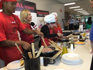 """Students help cook """"HEAL-icious"""" meals with HEAL Alabama founder, Christy Swaid and Birmingham's Kathy Mezrano with Kathy G.& Co., center, during Faulkner University's Wellness Week."""