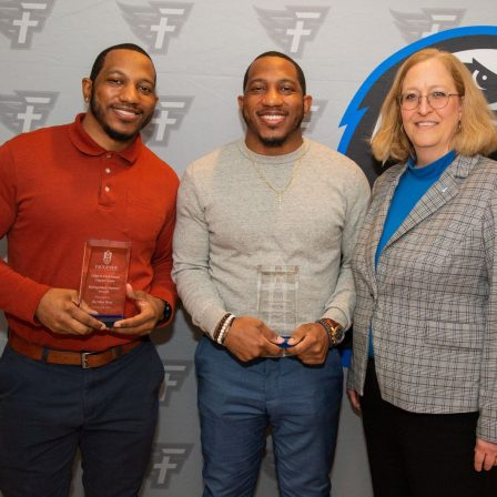 Ra'Mon and Ty'Ron West stand with Dr. Susan Hammon.