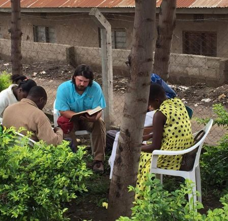 Justin Maynard teaches a Bible class to a group in Tanzania, Africa.