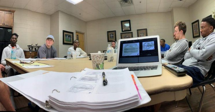 Faulkner University's Men's Basketball team takes part in an early morning Leadership Class.