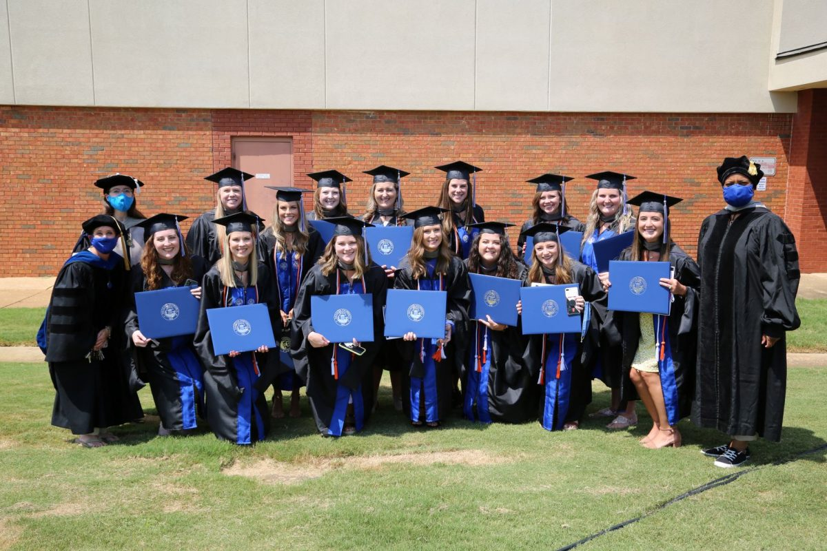 SLP graduates pose for a group picture following the 2020 Spring commencement ceremony.