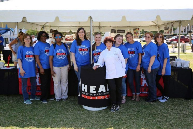 Faulkner faculty and staff joined Kathy Mezrano with Kathy G.& Co. to serve healthy treats during Alabama's HEAL Day.