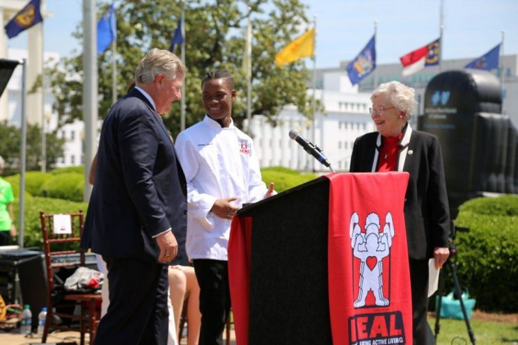 Future Eagle, Antoine Tatum, center was awarded Faulkner's first HEAL Scholarship by President Mike Williams and honored as a HEAL Hero by Gov. Kay Ivey on the inaugural HEAL Day at the Alabama Capitol.