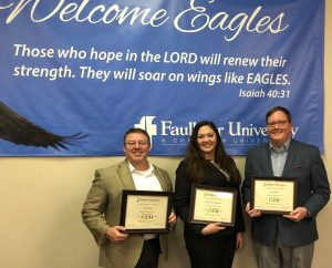 Jason Isbell, right, stands with left to right, Paul Evans and Sheena Ariel Riley Gore after presenting at the Marketplace Faith Forums on Feb. 16, 2018.