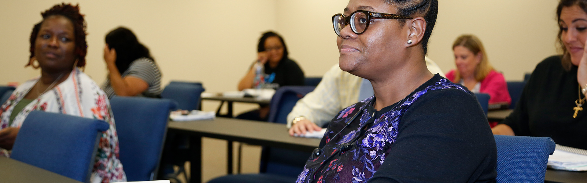 Adult student attends a seminar class within the Faulkner College of Business