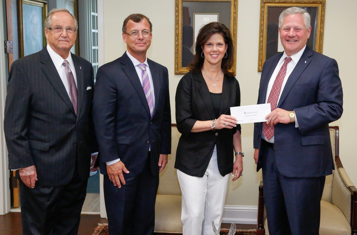 Alabama Power executives Mike Jordan and Leslie Sanders presents a grant for the College of Health Sciences to President Mike Williams and Vice Chancellor Wayne Baker.