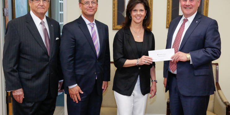 Alabama Power executives Mike Jordan and Leslie Sanders presents a grant for the College of Health Sciences to President Mike Williams and Chancellor Wayne Baker.