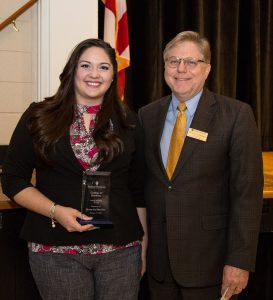 Sheena Ariel Riley Gore stands with David Johnson after being awarded the College of Business Young Alumna of the Year Award.