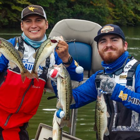 Christian Rines, left and Ben Garcia pose with their bass.