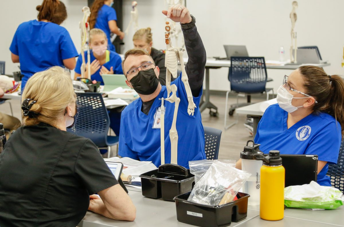 College of Health students conduct class in one of the new labs.