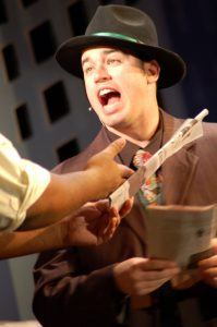 Daniel Monplaisir plays one of the leads in Faulkner Dinner Theater's play, Guys and Dolls.