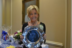 Dr. Dixie Hicks holds a platter given to her as a gift as her retirement reception at Faulkner University.