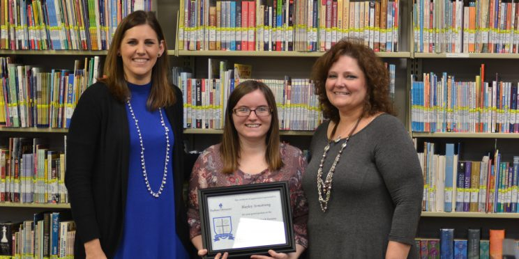 Haley Armstrong, center is honored at Marketplace Faith Friday Forums.