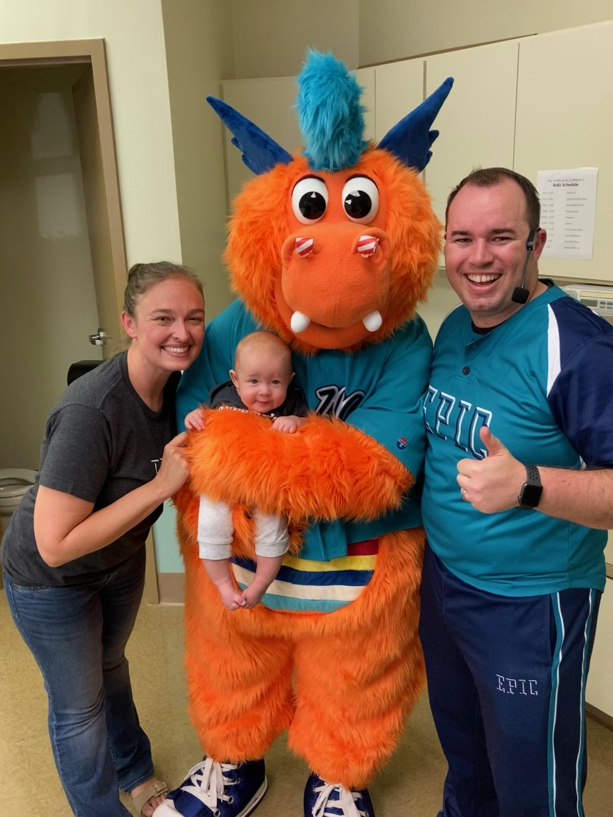Daniel Monplaisir with wife Ashley, family and EPIC Entertainment mascot, Kazoo.