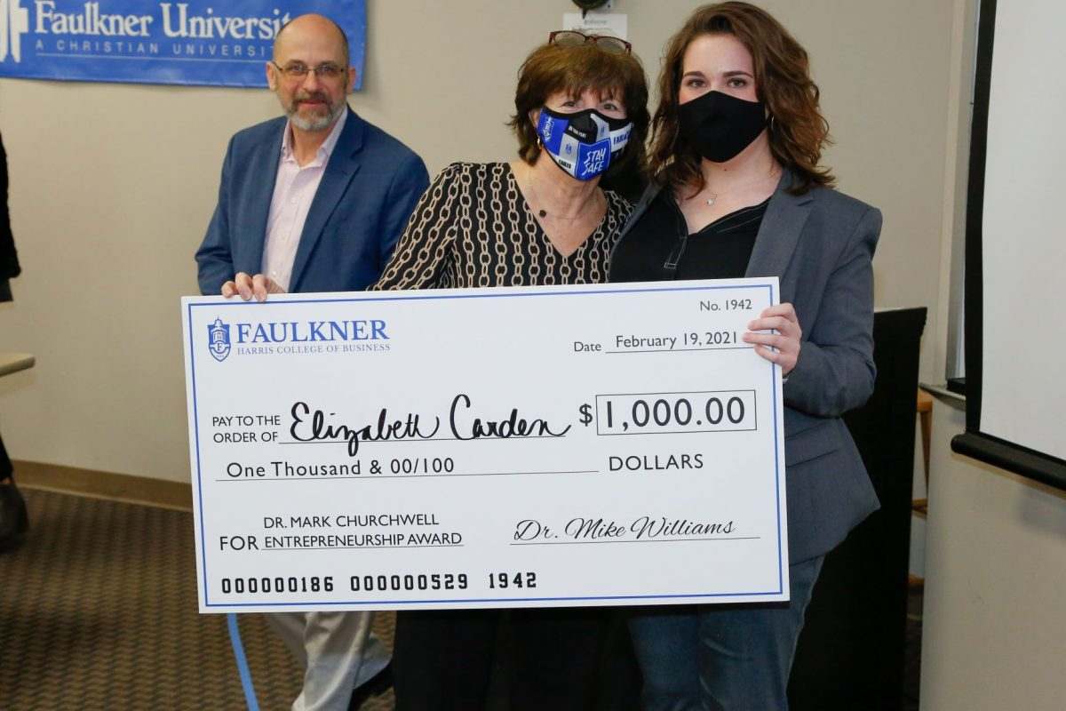Elizabeth Carden, right, holds a check for $1,000 for the Dr. Mark Churchwell Entrepreneurship Award. Next to her are Donna Churchwell and David Gregor.
