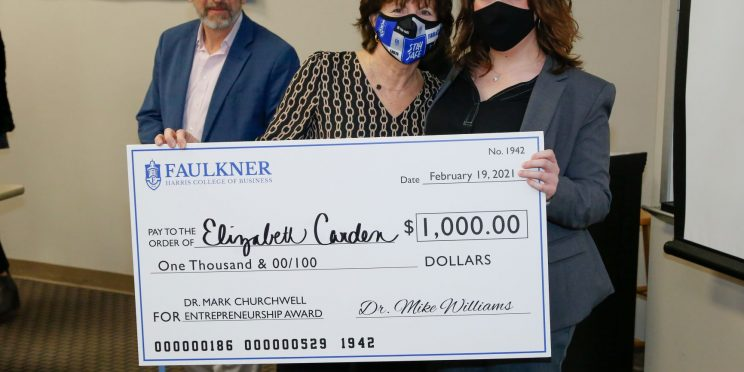 Elizabeth Carden, right, holds a check for $1,000. Next to her are Donna Churchwell and David Gregor.