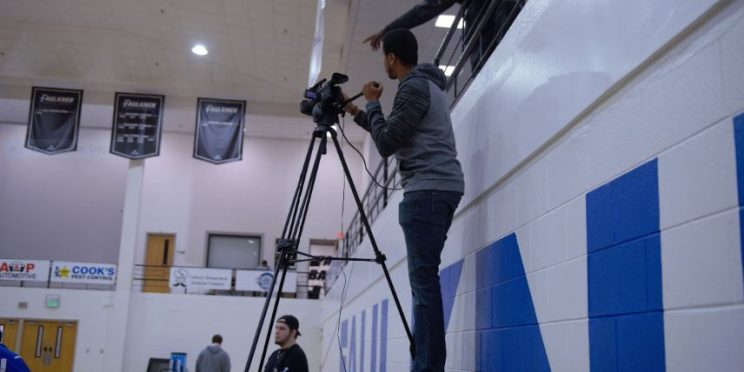 Jacob Hartsfield with the Faulkner Sports Network mans the camera during this season's games while Keavonte' Lindsey assists in the balcony.
