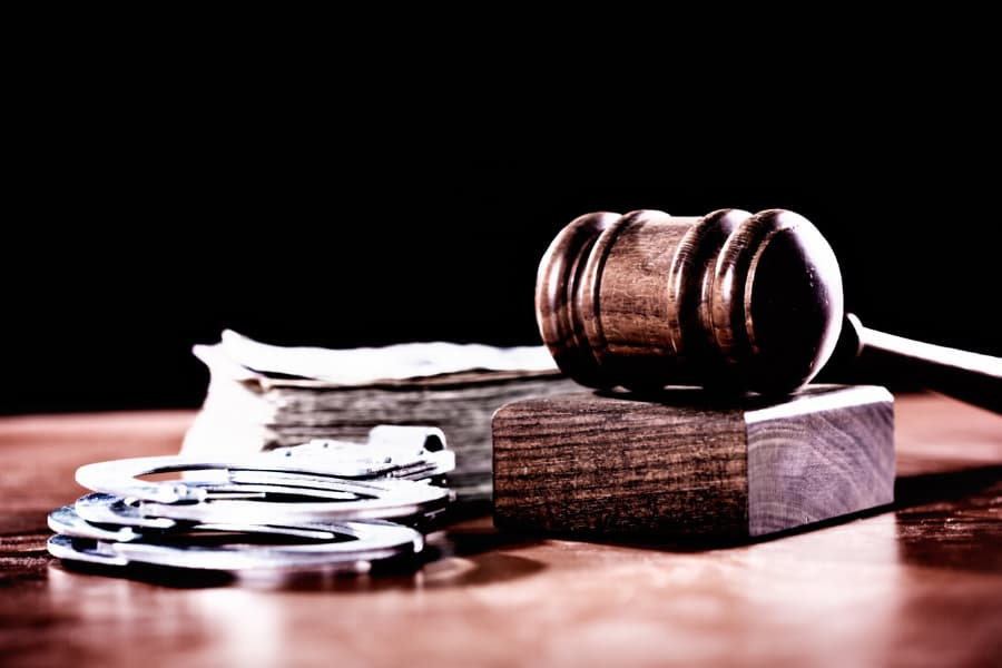 Gavel with banknotes and handcuffs