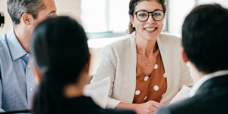 Human resources manager meets with coworkers