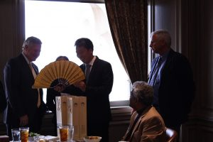 President Mike Williams inspects a traditional Chinese fan presented to the school as a gift of friendship given by Faulkner's guests from Xiangyang Vocational and Technical College in China.