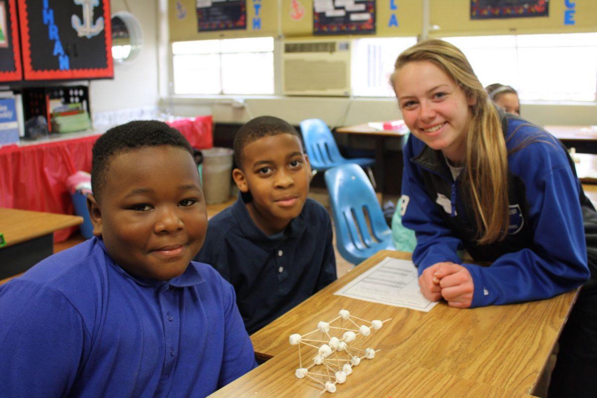 Faulkner students teach children at Davis.