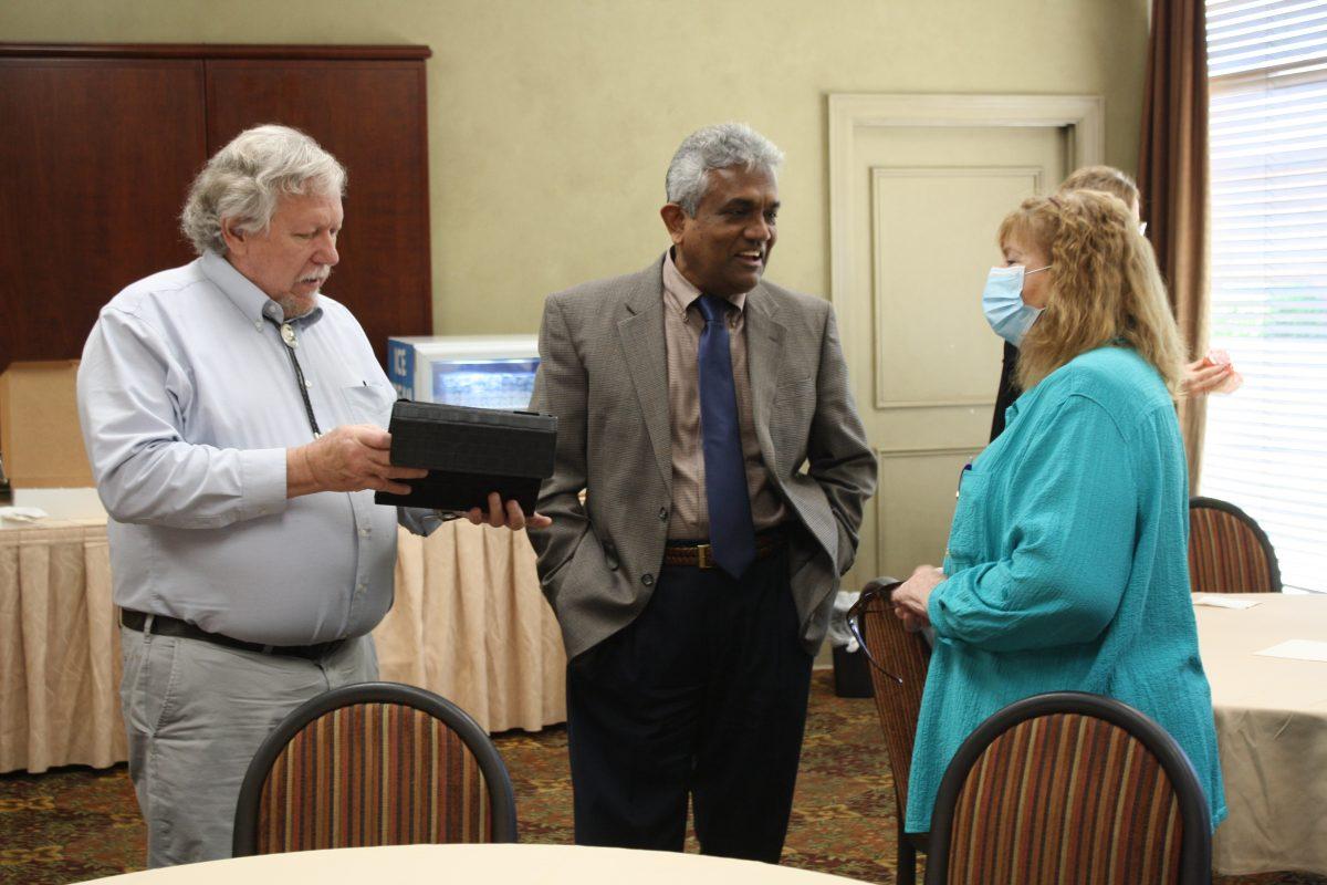 l-r Dr. Al Schlundt, Dr. Dave Rampersad and Terri Schlundt chat during Al Schlundt's retirement ceremony.