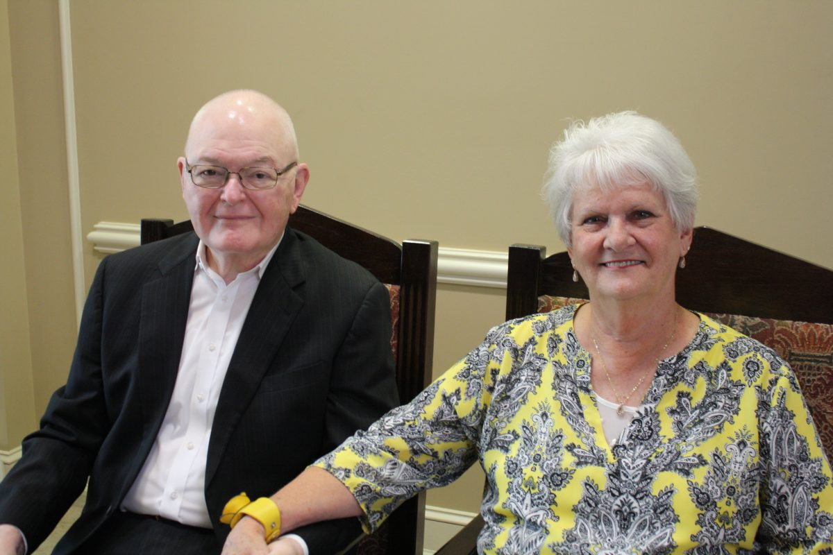 l-r Don Myers and Judy Myers sit together and hold hands during Don Myers retirement ceremony.