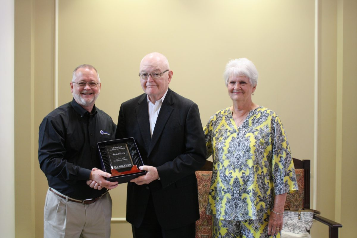 l-r Scott Gleaves, don Myers and Judy Myers. Gleaves presents Don Myers with a commemorative plaque during his retirement ceremony.