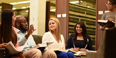 Law students at Thomas Good Jones School of Law library