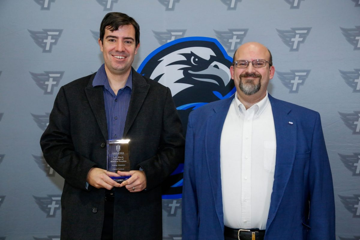 Caleb Cochran and Dr. Todd Brenneman. Cochran is awarded the Young Alumnus Award for the VP Black College of Biblical Studies. Cochran pursued a life in ministry thanks to his professors and classes at Faulkner.