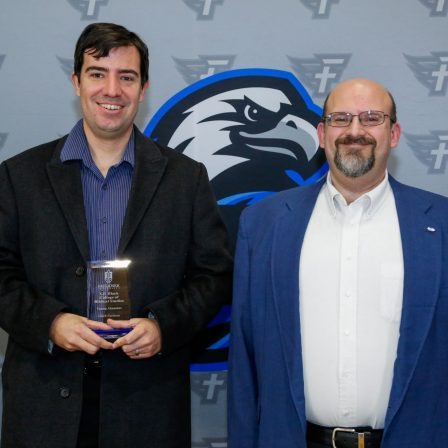 Caleb Cochran and Dr. Todd Brenneman. Cochran is awarded the Young Alumnus Award for the VP Black College of Biblical Studies.