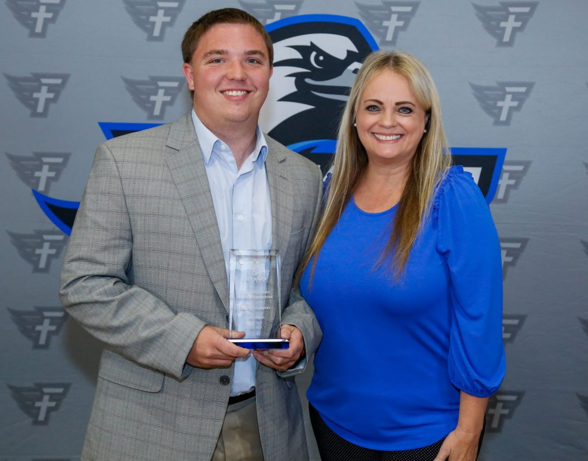 l-r Cody Davis and Dr. Donna Clemons. Davis is presented with the Young Alumnus Award for the Marketplace Faith Friday Forums. He works as a coach for Montevallo High School.