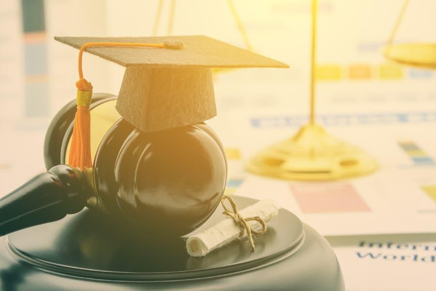 Mini Graduation cap on top of gavel