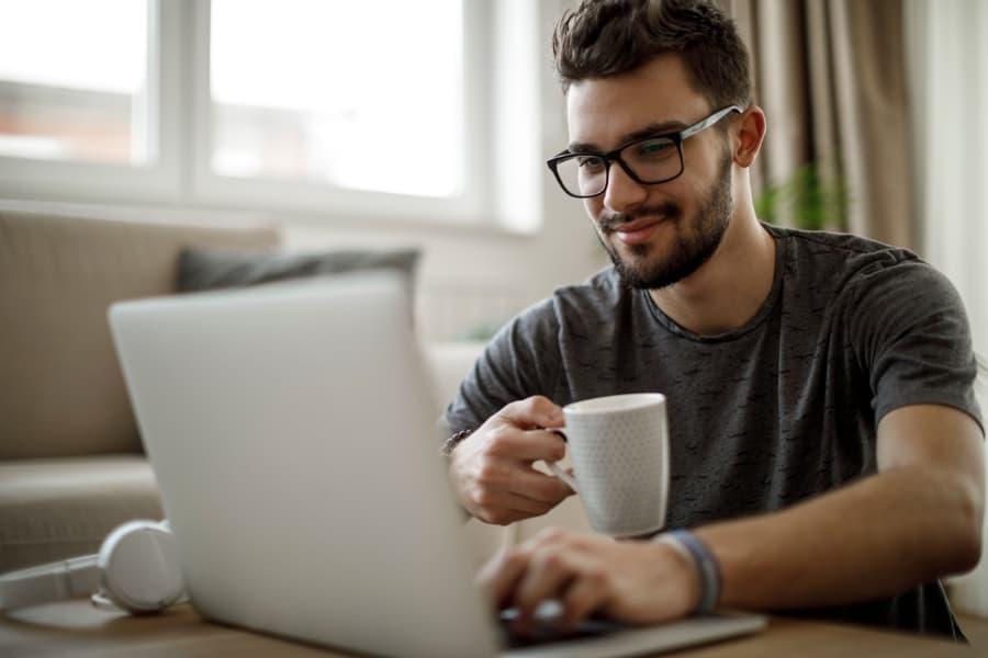 Man Studies At Home