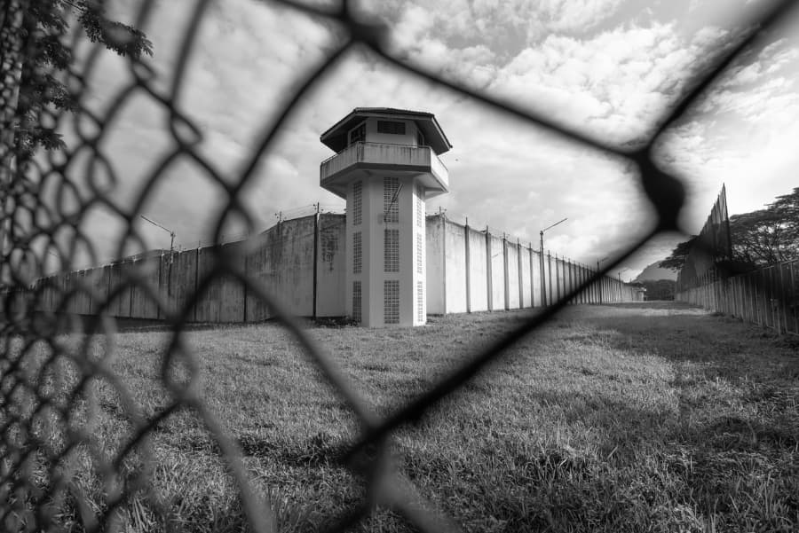 Prison watchtower behind fence
