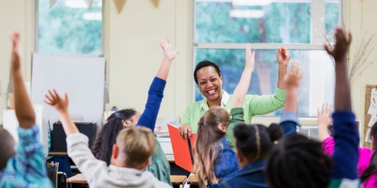 Teacher reading to elementary school children