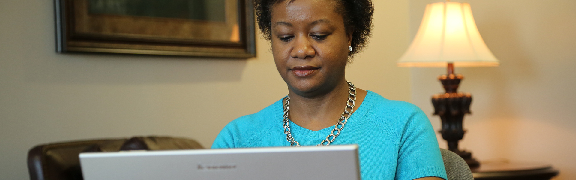 Cropped Photo of Woman Taking Class Online