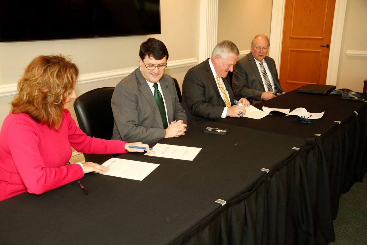 2: l-r Judge Carole Medley, W. Kirk Brothers, Mike Williams and Dale Kirkland sign a Memorandum of Understanding on Faulkner's Montgomery campus on September 30, 2021.