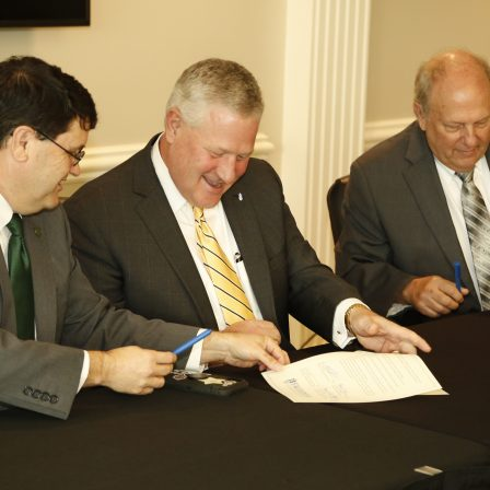 l-r W. Kirk Brothers, Mike Williams and Dale Kirkland sign a Memorandum of Understanding on Faulkner's Montgomery campus on September 30, 2021.