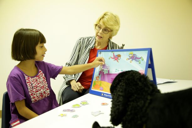 Dr. Sheela Stuart works with young patient Olivia at Faulkner University's new Speech and Language Pathology Clinic on Aug. 3.