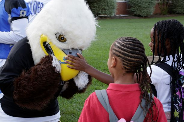 Baldwin greets Davis Elementary students back to school on Monday.