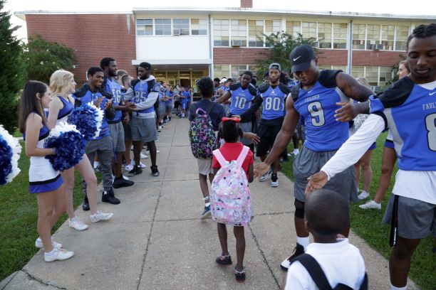 Faulkner athletes welcome Davis Elementary students back to school on Monday.